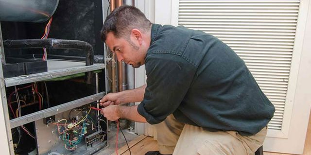 RMG Air Conditioning and Heating Services working on Residiential Heating