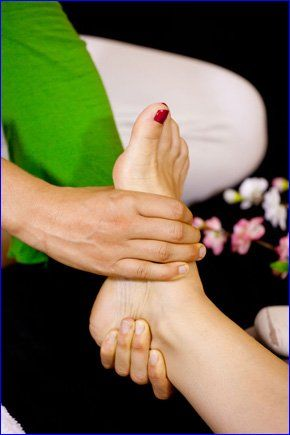 A foot being treated by a chiropodist