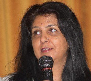 Sarbjit Athwal speaking at a conference
