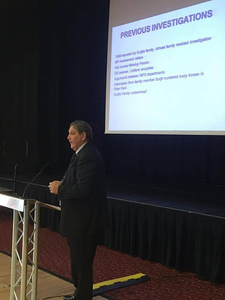 Clive Driscoll on stage speaking to West Midlands Police