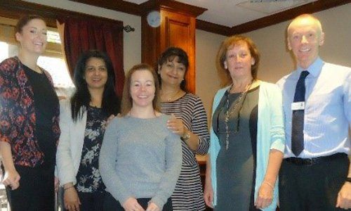 Surrey Police HQ –  Sarbjit with staff members and survivors