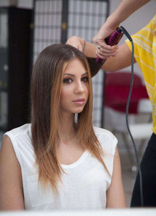 Customer getting her hair styled by an expert