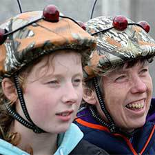 teenagers having fun and wearing laser tag helmets
