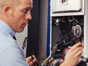 Man repairing sump pumps