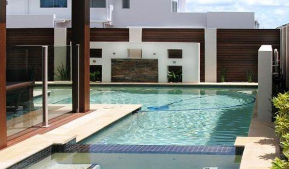 Modern swimming pool and glass fencing