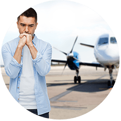 phobia, fear, sorrow and people concept - unhappy man thinking over airplane on runway background