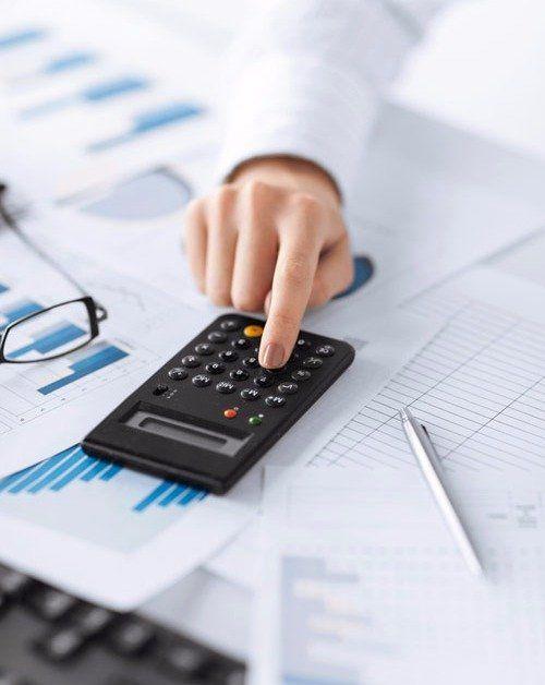 Accountant cross checking the account balance sheets