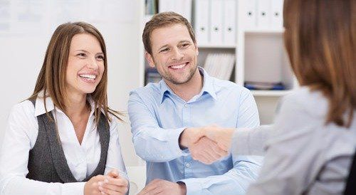 Accounting professional discussing the payroll report with clients