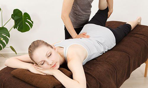 Caucasian woman undergoing a chiropractic