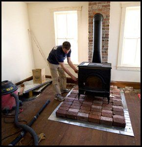 chimney sweep sweeping out a large stove