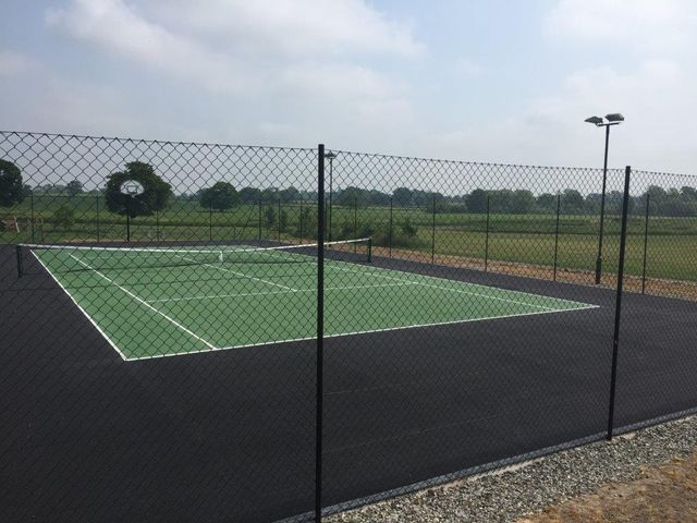 tennis court with black surround