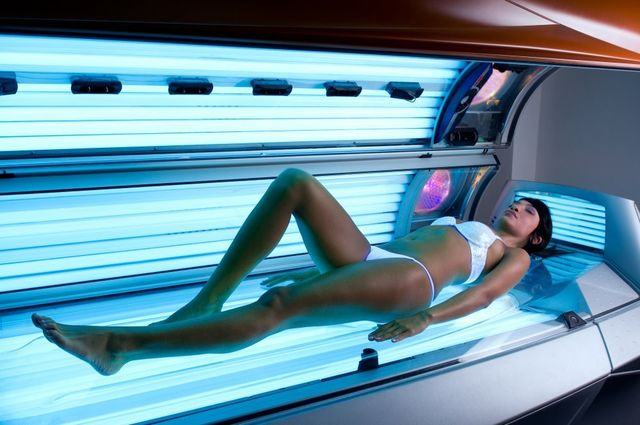 Beautiful lady lying on a tanning bed