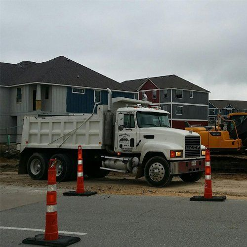 dump truck services Bryan TX