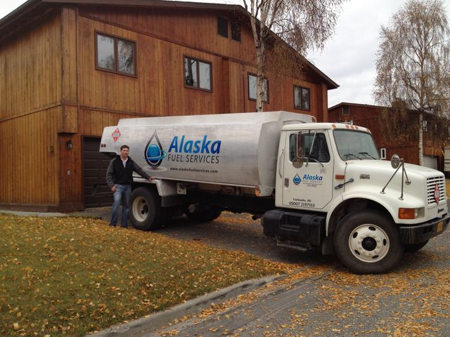 An Alaska Fuel Services' truck in front of a clients house