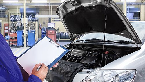 Most trusted mechanic examining automobile's problem in Saint Peters, MO