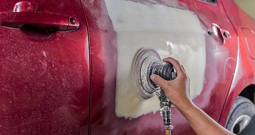 Expert painting the automobile in Columbia Falls, MT