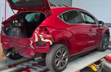 red car body work