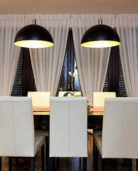 High quality fabric, textured curtains in the dining room
