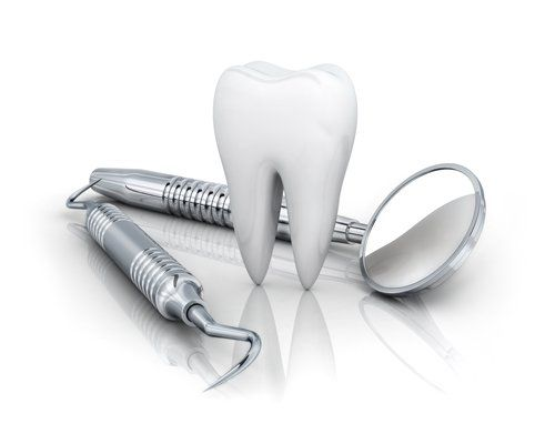 modellino di dente con specchietto e strumenti del dentista