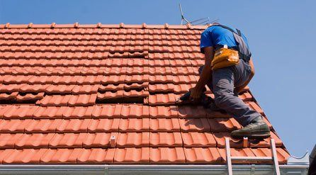 roofer fitting plastic roof tiles