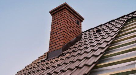 new chimney and partly tiled roof