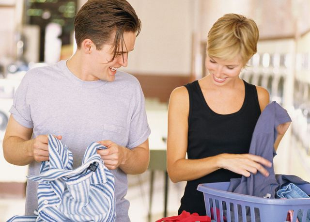 A happy couple doing their laundry in Christchurch thanks to our washing machine repair service