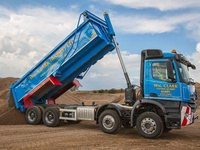 unloading of blue truck