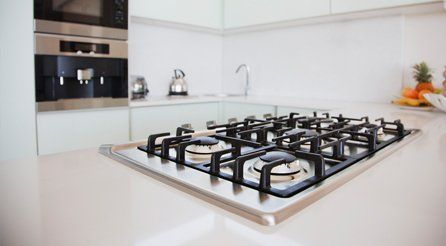 A gas hob in a spotlessly clean kitchen