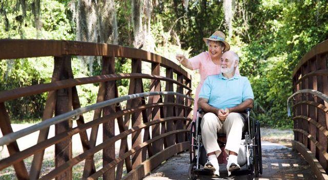 a couple on a wheel chair