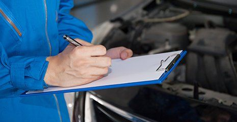 Mechanic examining a vehicle in Montgomery