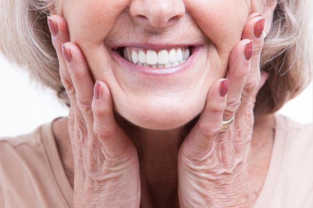 lady smiling with new dentures