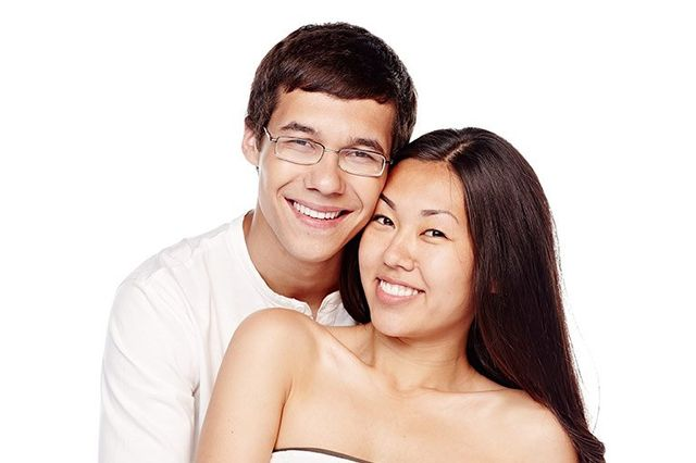 couple smiling after wisdom teeth removal