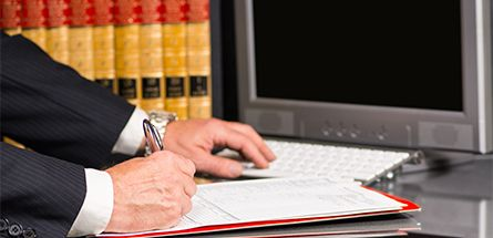 Private attorney signing documents in High Point, NC