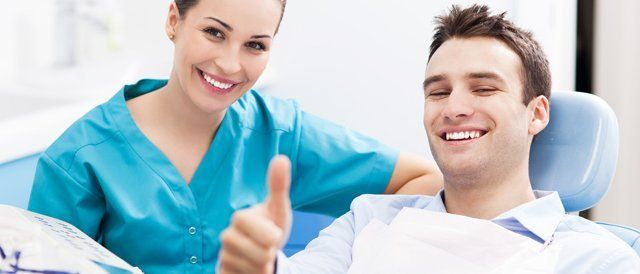 dental patient with thumbs up