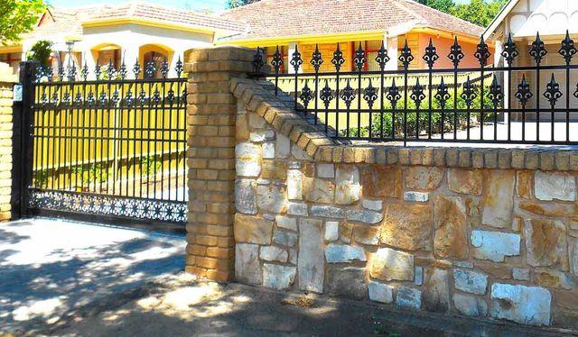 EUREKA DESIGN SLIDING AUTO GATE WITH CUSTOM MADE PANELS