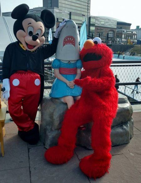Costumed character lookalikes Mickey mouse and Elmo
