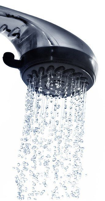 hot water flowing from a chrome shower head