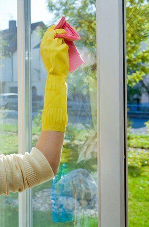 Cleaner washing inside of windows