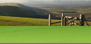 A wooden kissing-gate on a hillside