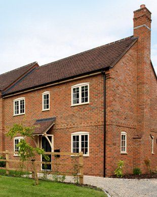New build red brick house build by L C Construction