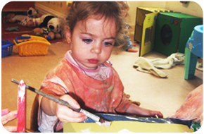 A little girl painting a picture