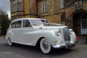 Chauffeur driven wedding car