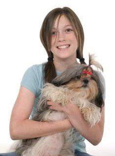 girl holding Shih Tzu dog