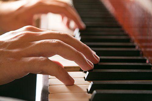 Individual playing piano