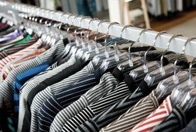 A row of striped tops on hangers