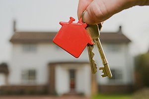House keys and red plastic house shaped key fob