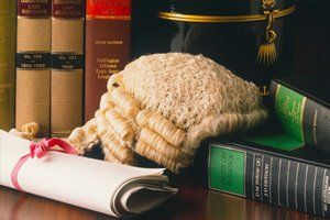 Legal horsehair wig and pink ribbon bound document