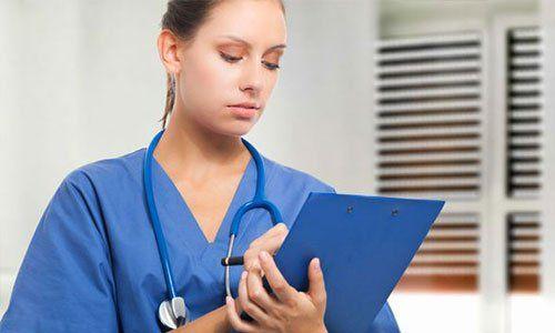Portrait of a nurse writing notes