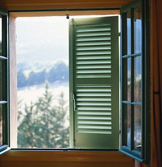 An open window with green shutters