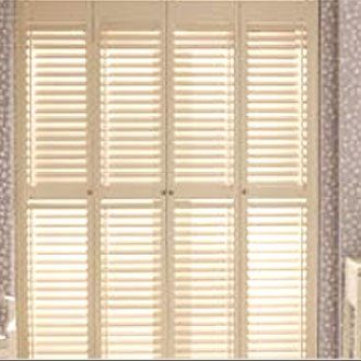 Cream full height shutters